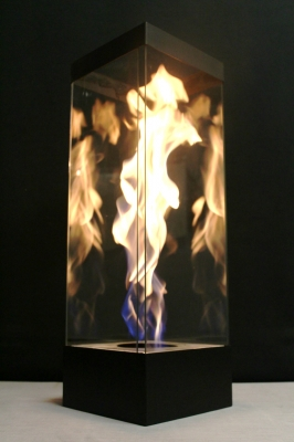 Large portable fire feature in glass swirl flame